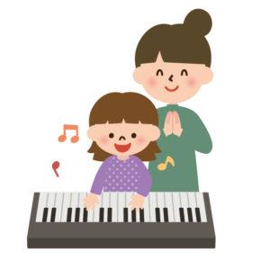 ピアノ教室でレッスンを受ける生徒とピアノ講師
